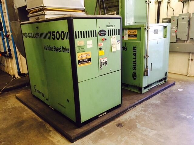 The serviced and adjusted 100-hp VSD air compressor, along with the retrofitted 75-hp air compressor — both from Sullair