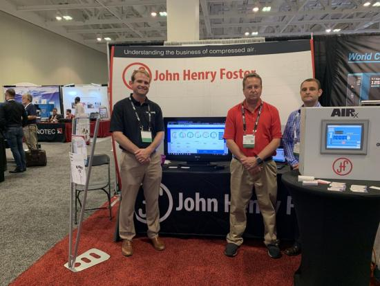 Christian Corrigan, Mark Ames and Kevin Dodd at the John Henry Foster booth